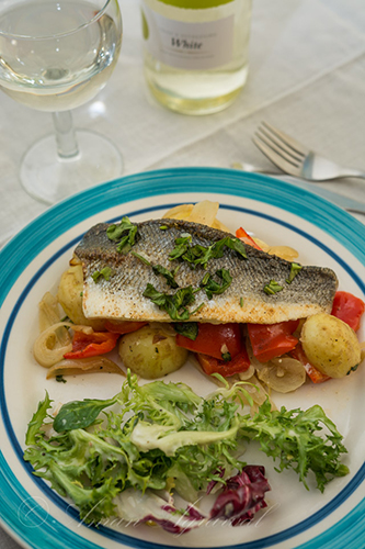 baked Sea Bass on plate with wine image